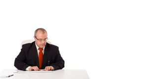 Businessman sitting at desk and typing on keyboard with copy sca Stock Images