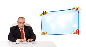 Businessman sitting at desk and typing on keyboard with copy spa Royalty Free Stock Photo