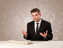 Businessman sitting at a desk Stock Photo