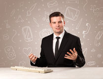 Businessman sitting at a desk Stock Photography
