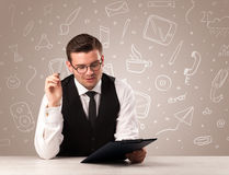 Businessman sitting at a desk Royalty Free Stock Photos