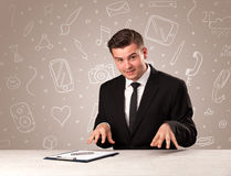 Businessman sitting at a desk Royalty Free Stock Image