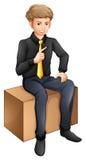 A businessman sitting down Stock Photos