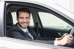 Businessman sitting in drivers seat Stock Image