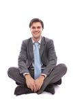 Businessman sitting on the floor Stock Photos