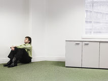 Businessman Sitting On Floor In Corner At Office Stock Photos