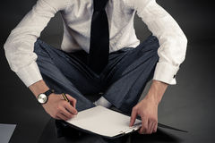 Businessman sitting on the floor Royalty Free Stock Photo