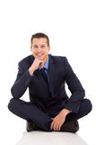 Businessman sitting floor Stock Photos