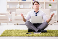 The businessman sitting on the floor in office. Businessman sitting on the floor in office Stock Images