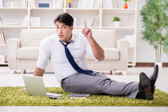 The businessman sitting on the floor in office Royalty Free Stock Image