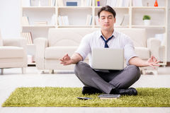 The businessman sitting on the floor in office Stock Image