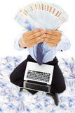 Businessman sitting on floor and showing the money Royalty Free Stock Image