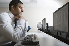 Businessman Sitting In Front Of Desktop PC Stock Images