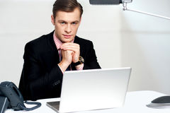 Businessman sitting in front of laptop Royalty Free Stock Photography