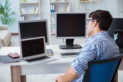 The businessman sitting in front of many screens Royalty Free Stock Photography