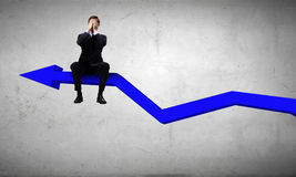 Businessman sitting on graph Stock Image