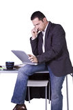 Businessman Sitting At His Desk Stock Image