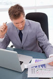 Businessman sitting at his desk Stock Images