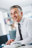 Businessman sitting at his desk Royalty Free Stock Image