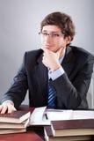 Businessman sitting at his desk Stock Image