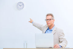 Businessman sitting at his desk Royalty Free Stock Photography