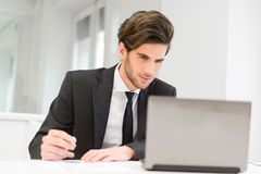Businessman sitting at his laptop Royalty Free Stock Photo