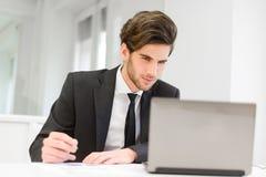 Businessman sitting at his laptop Royalty Free Stock Photo