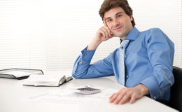 Businessman sitting in his office Stock Photography