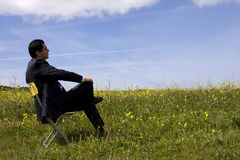 Free Businessman Sitting In A Yellow Chair Royalty Free Stock Photo - 4809475