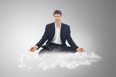Businessman Sitting In Lotus Position Royalty Free Stock Image