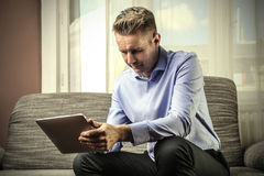 Businessman sitting indoors Stock Photos