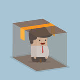 Businessman sitting inside the box Stock Photography