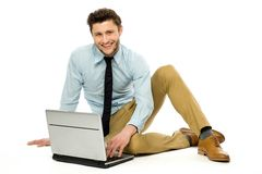 Businessman sitting with laptop Royalty Free Stock Photos