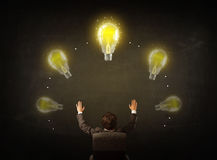 Businessman sitting with lightbulbs over his head Stock Photography