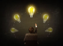Businessman sitting with lightbulbs over his head Royalty Free Stock Photo