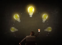Businessman sitting with lightbulbs over his head Stock Images