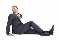 Businessman sitting and looking up Stock Photo