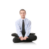 Businessman sitting in lotus position Stock Photo