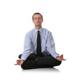 Businessman sitting in lotus position. Isolated against white background Royalty Free Stock Image