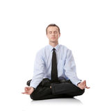 Businessman sitting in lotus position. Isolated against white background Stock Photos