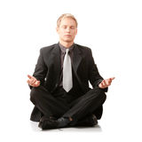 Businessman sitting in lotus position. Isolated Royalty Free Stock Image
