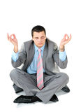 Businessman sitting in lotus position Stock Images