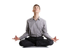 Businessman sitting in lotus position Stock Image