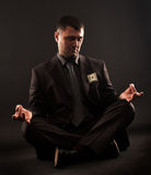 Businessman sitting in lotus position,meditateing. Royalty Free Stock Images