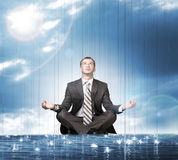 Businessman sitting in lotus position on water Stock Photos