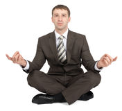 Businessman sitting in lotus posture Royalty Free Stock Images