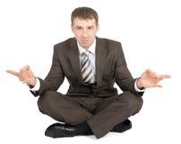 Businessman sitting in lotus posture Royalty Free Stock Photo