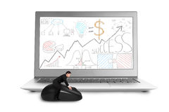 Businessman sitting on mouse with laptop Stock Photo