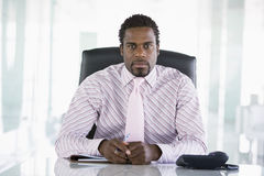 Businessman sitting in office Royalty Free Stock Image