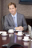 Businessman Sitting in Office Boardroom Royalty Free Stock Images